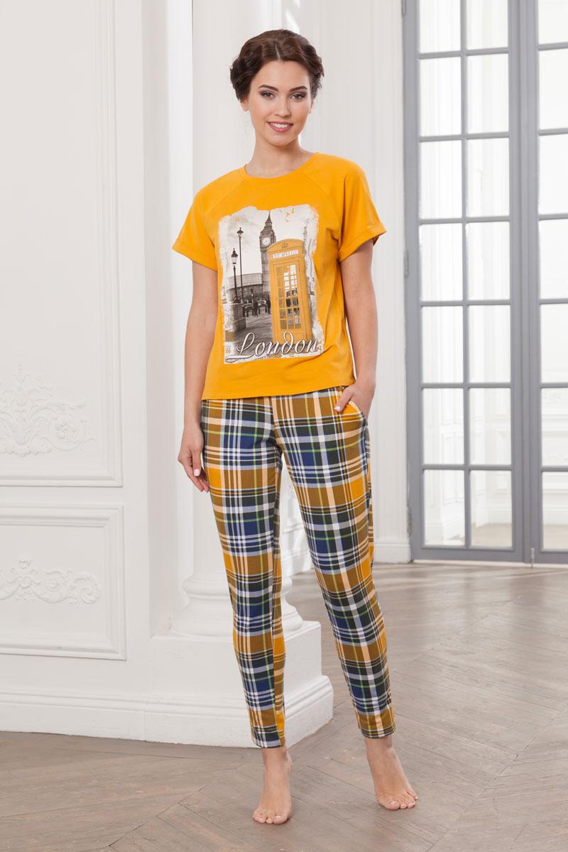 Комплект домашний женский Cleo Лондон, цвет: желтый. 729. Размер 46729Домашний комплект состоит из футболки и брюк, которые выполнены из набивного и гладкокрашеного хлопкового трикотажа кулир. Отделкой служит красочный шелкографический рисунок на переде футболки. Брюки зауженные к низу, длинные, с карманами. Пояс из эластичной резинки. Рукава футболки короткие, покроя реглан. В боковых швах по низу выполнены небольшие разрезы.
