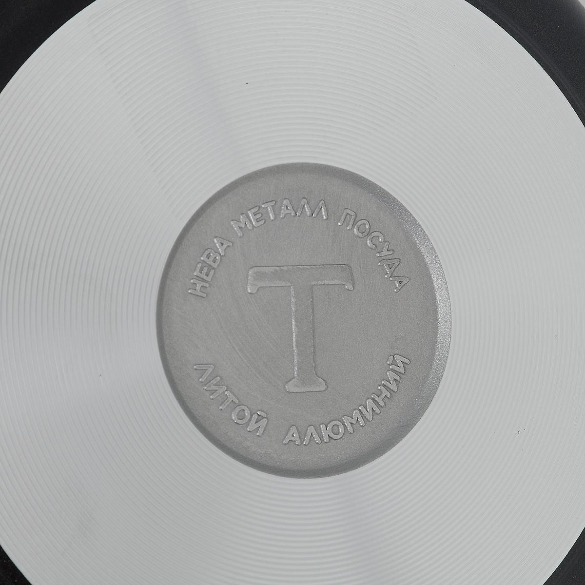 """Сковорода """"Особенная"""" из серии литой алюминиевой посуды с полимер-керамическим антипригарным покрытием повышенной износостойкости ТИТАН. Вы можете пользоваться металлическими столовыми приборами, готовя в ней пищу. 4-слойная антипригарнвя полимер-керамическая система ТИТАН ПК обладает повышенной износостойкостью, достигаемой за счет особой структуры и специальной технологии нанесения. Это собственная запатентованная разработка компании, не имеющая аналогов в России. Прототип покрытия применялся при постройке космического корабля Буран и орбитальных спутников. В состав системы ТИТАН ПК входят антипригарные слои на водной основе. Система ТИТАН ПК традиционно производится БЕЗ использования PFOA (перфтороктановой кислоты). Равномерно нагревается за счет особой конструкции корпуса по принципу """"золотого сечения"""", толстых стенок (4-4,5 мм) и ещё более толстого дна (6-8 мм). Приготовленная еда получается особенно вкусной благодаря специфическим термоаккумулирующим свойствам литого алюминия. Корпус, отлитый вручную, практически не подвержен деформации даже при сильном нагреве.        Подходит для газовых, электрических и стеклокерамических плит. Посуду можно мыть в посудомоечной машине. Не боится царапин!    Гарантия 3 года. При соблюдении правил эксплуатации срок службы не ограничен. Характеристики:  Материал: алюминий. Диаметр сковороды: 20 см. Высота стенки: 5,2 см. Длина ручки: 18 см. Диаметр дна: 14,2 см. Толщина стенок: 4 мм. Толщина дна: 6 мм. Производитель: Россия. Размер упаковки: 38 см х 21 см х 5,2 см. Артикул: 9120."""