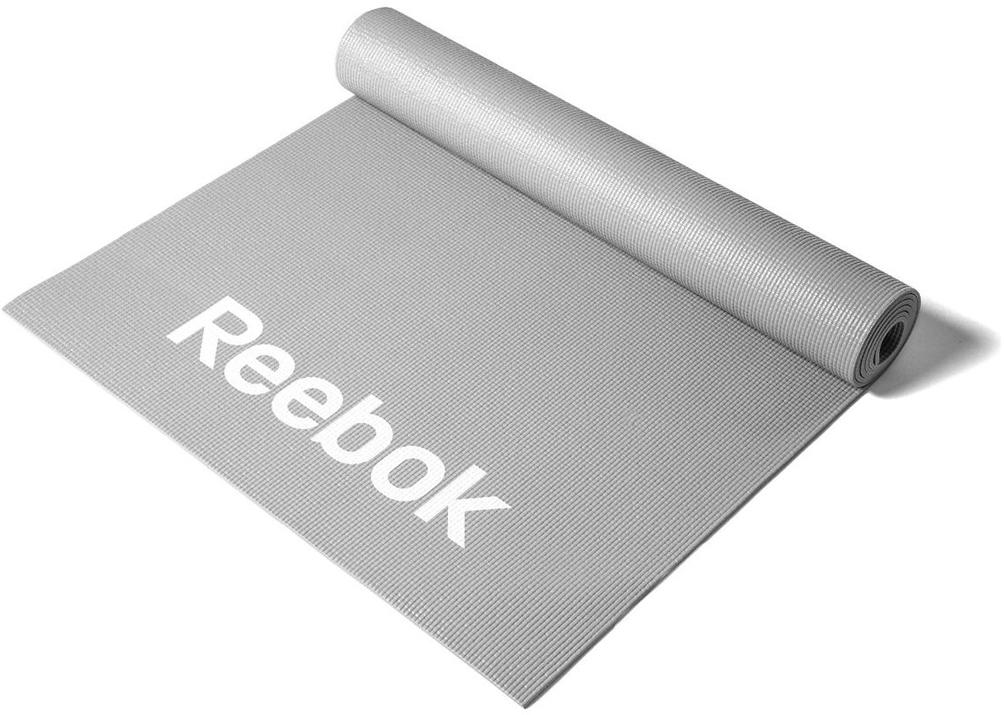Тренировочный коврик для фитнеса Reebok Love, тонкий, цвет: серыйRAMT-11024GRLТренировочный мат - это базовый аксессуар каждого увлеченного энтузиаста фитнеса, йоги или пилатеса, но имея широчайший выбор форм, размеров и материалов, порой непросто остановиться на том, который идеально подходит именно вам. Созданный для упражнений (выполняемых на полу) на развития силы, осанки, и гибкости, стильный мат Reebok Love имеет размеры 173 x 61 см и толщину 4 мм и обеспечивает комфортную поддержку вашим рукам, спине и ступням при выполнении любых типов упражнений. Благодаря нескользящему покрытию коврика, вы сможете совершать любые движения, и коврик не будет приподниматься от пола, а останется в том же положении, где и был в начале тренировки. Серый фитнес-мат является стильным и очень практичным выбором. Подходит для различных тренировок.