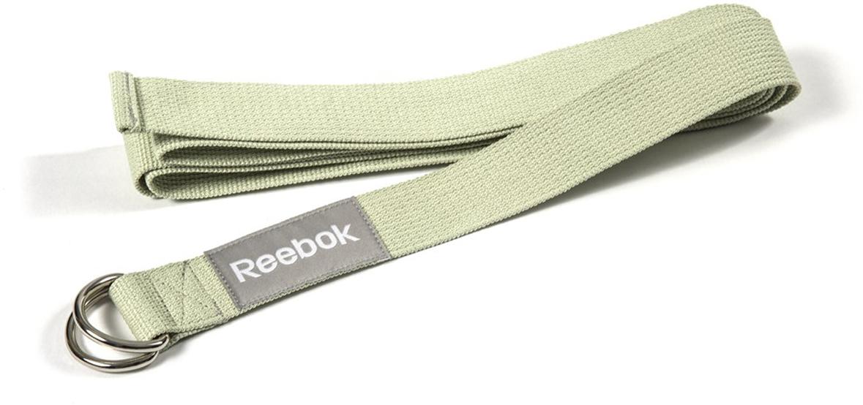 Ремень для йоги Reebok, цвет: зеленыйRAYG-10023GNРемень для йоги длиной 2.5 м помогает вам лучше отстраивать, выравнивать позы и продвигаться к более сложным вариациям. Ремень поможет значительно увеличить длину захвата, для рук и ног, позволяя вам правильным образом совершенствовать гибкость. Например, если вы только приступаете к тренировкам и еще не до конца освоили полный прогиб сидя к прямым ногам, вы можете использовать ремень для йоги Reebok, чтобы облегчить позу, полностью выпрямить ноги и выпрямить спину, не напрягая ее - так, как это должно быть при правильной отстройке позы.Ремень имеет крепкую пряжку из двух металлических скоб, позволяющую удерживать его на месте. Это чрезвычайно важно при отработке новых более сложных поз. Использую ремень, вы избежите растяжения конечностей или других возможных травм.Ремень для йоги Reebok важный и практичный аксессуар для занятий йогой, необходимый как для начального, так и продвинутого уровней. Длина 2.5 м.Помогает в отстройке и выравнивании поз.Зеленый ремень для йоги.Крепкая пряжка удерживает ремень на месте.