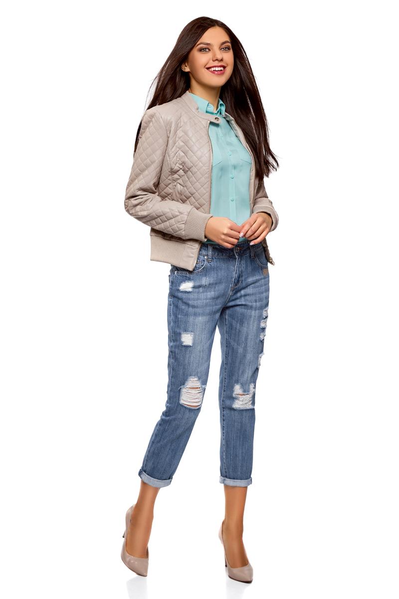 Джинсы женские oodji Ultra, цвет: синий джинс. 12105101-2/42559/7500W. Размер 28 (46)12105101-2/42559/7500WДжинсы от oodji с прорехами выполнены из хлопкового денима. Модель Boyfriend в поясе застегивается на пуговицу, имеет ширинку на молнии и шлевки для ремня. Джинсы имеют классический пятикарманный крой.