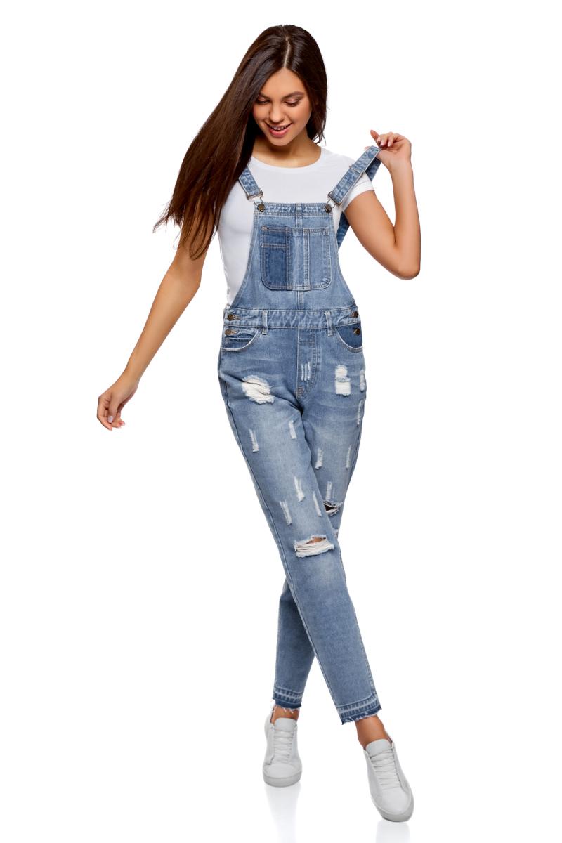 Полукомбинезон женский oodji Ultra, цвет: голубой джинс. 13108002-1/45254/7000W. Размер 36-170 (42-170)13108002-1/45254/7000WКомбинезон джинсовый от oodji с отделкой в стиле пэчворк выполнен из хлопкового денима. Модель с регулируемыми лямками по бокам застегивается на пуговицы, имеет классический пятикарманный крой, на груди дополнена накладным карманом.