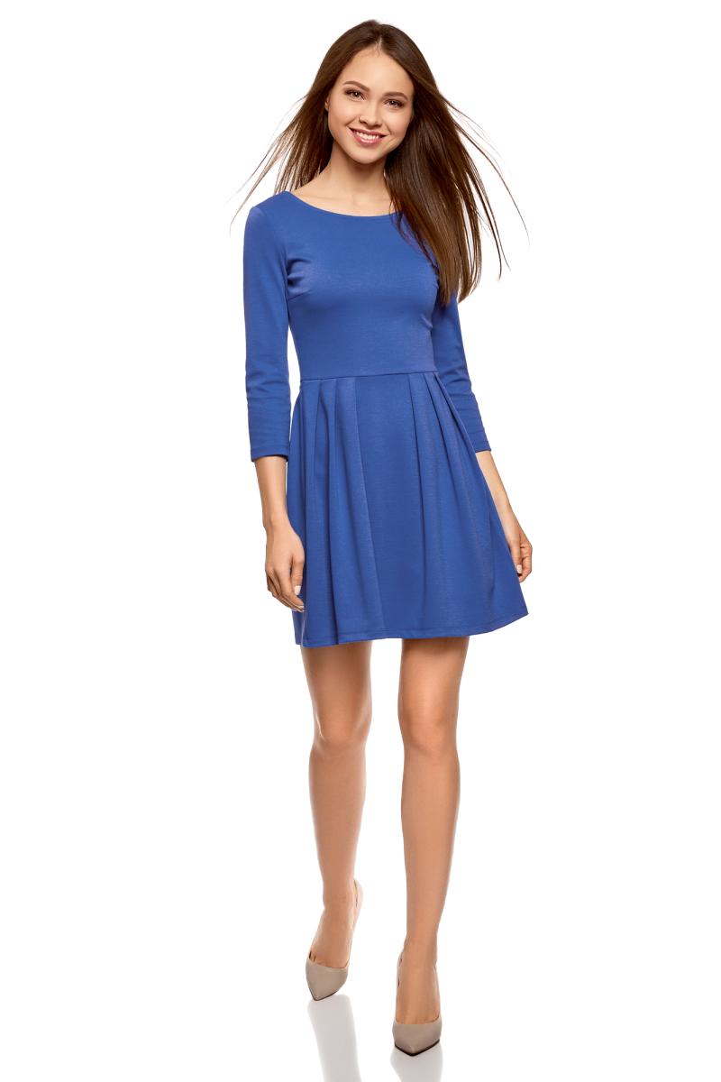 Платье oodji Ultra, цвет: синий. 14011005B/38261/7500N. Размер L (48)14011005B/38261/7500NТрикотажное платье от oodji выполнено из эластичного полиэстера с добавлением вискозы. Модель с рукавами 3/4 и круглым вырезом горловины на спинке застегивается на молнию.