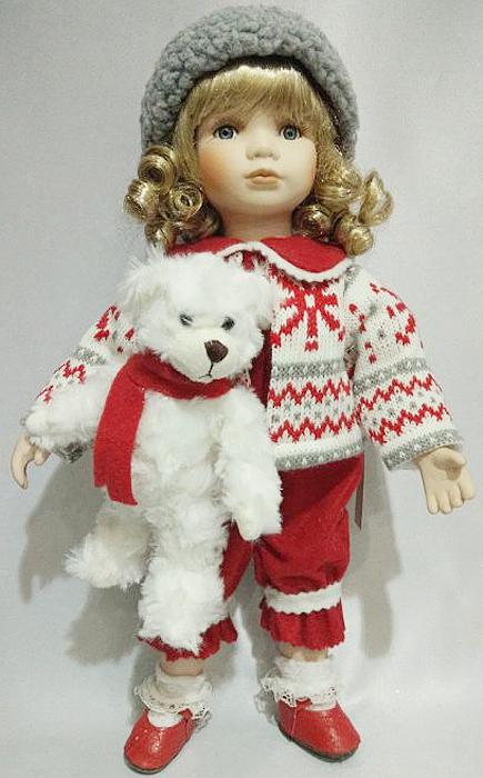 Фигурка декоративная Девочка, 36 см, цвет: красный. 1606816068Сувенирные куклы служат прекрасным подарком не только для коллекционера, они дарятрадость, когда мы ими любуемся, прекрасно вписываются в любой интерьер.