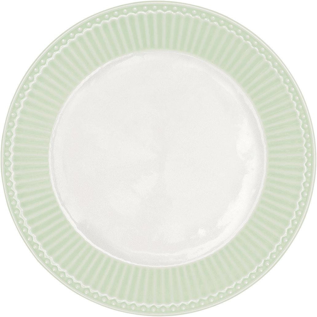 Тарелка датского производства Alice pale green, выполненная из высококачественного фарфора, несомненно, станет украшением как праздничного стола, так и повседневной сервировки.  Базовая коллекция Alice создана для идеального сочетания посуды ранних и будущих коллекций Greengate. Впервые появилась в каталогах в 2016 году и с тех пор завоевала миллионы сердец своей универсальностью, насыщенными цветами и разнообразием посудной линейки. Alice dark blue – настоящая находка для тех, кто хочет освежить сервировку, придать ей благородные нотки классическим и глубоким синим цветом. Разнообразие предметов посуды в линейке позволяет коллекции быть как базой, так и связующим звеном с цветочными орнаментами коллекций Amanda indigo, Audrey indigo, Sally и с др.