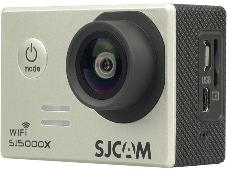 SJCAM SJ5000X Elite, Silver экшн-камераSJCAM SJ5000X silver;SJCAM SJ5000X silverЭкшн-камера SJCAM SJ5000X Elite - это отлично зарекомендовавшая себя модель среднего ценового диапазона, которую отличает стильный внешний дизайн, удобство и функциональность использования. Это первая модель SJCAM, способная снимать в интерполированном разрешении 4K. Она идеально подойдет тем пользователям, которые мечтают выйти за рамки Full HD видео с частотой 30 кадров/в сек.Внешне данная камера может иметь несколько вариантов исполнения по цвету. В отличии от предыдущих моделей, камера получила новый экран и другое исполнение кнопок управления. Это связано с сокращением производственных расходов и отлаженной эргономикой, которая успешно прошла все тесты и практические испытания на работоспособность. Корпус камеры отличается компактными размерами (61/42/25 мм) и малым весом (всего 68 грамм). Плюс в том, что эту модель можно применять для спонтанной съемки, нося камеру с собой в сумке.SJ5000X Elite отличает удобное расположение всех элементов. Вы легко и просто сможете включать режим Wi-Fi, перелистывать кадры, выключать камеру. Защитный кейс со специальным пружинным механизмом позволяет камере корректно функционировать даже в самых экстремальных условиях. Например, в воде или при сильном морозе.На правой части корпуса расположены: встроенный микрофон, слот для карты памяти MicroSD, разъемы MicroUSB и MicroHDMI. Стоит помнить о том, что высокое разрешение съемки нуждается в высокой скорости карты, поэтому к выбору накопителя стоит подходить ответственно.Камера имеет большой удобный экран и несколько информационных диодов которые отключаются при необходимости. Дисплей высокого качества, так что даже при ярком солнце изображение отлично видно.В качестве процессора в данной модели разработчики использовали Novatek 96660, который аппаратно может поддерживать 2К видео. Интерполяцией можно добиться разрешения 4К. Плюсом камеры является высококачественная матрица Sony IMX078, имеющая обратную