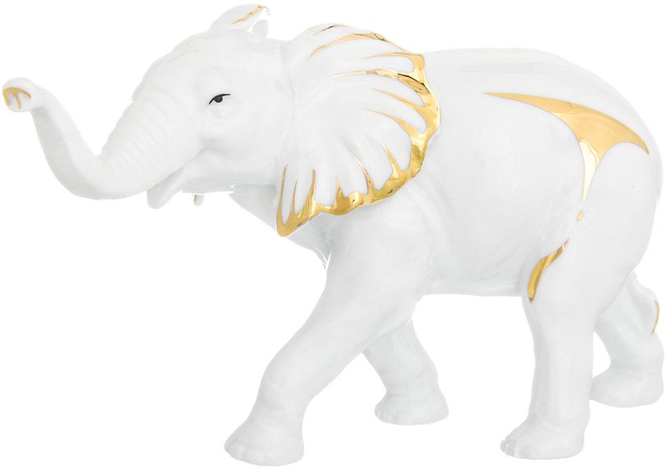 Фигурка декоративная Elan Gallery Слон, цвет: белый, 19 х 7 х 12 см330630Изящная фарфоровая статуэтка в классическом стиле Elan Gallery Слон украсит ваш дом, а также станет идеальным подарком.