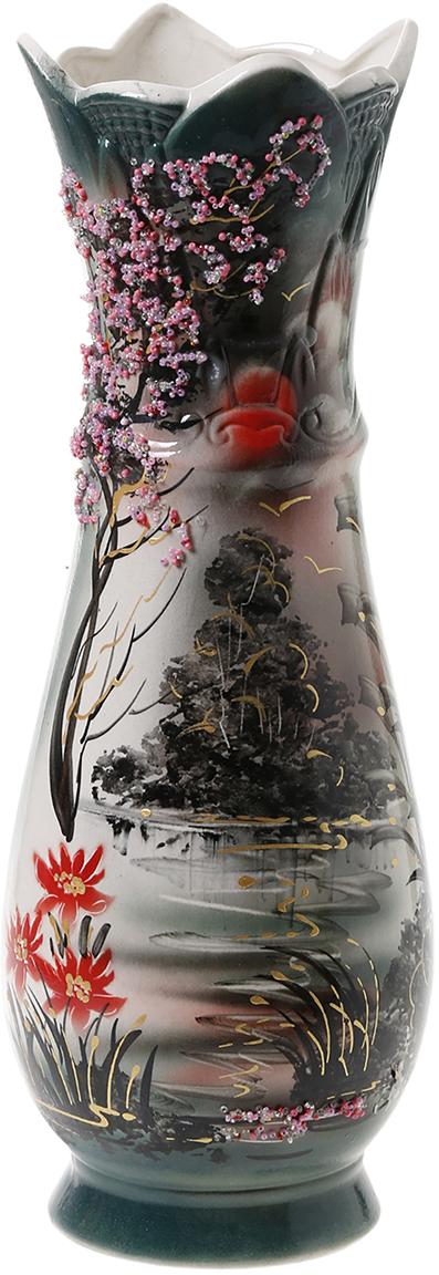Ваза напольная Керамика ручной работы Виктория, цвет: черный1034431Ваза напольная Виктория природа, бисер - отличный способ подчеркнуть общий стиль интерьера. Существует множество причин иметь такой предмет дома. Вот лишь некоторые из них: Формирование праздничного настроения. Можно украсить вазу к Новому году гирляндой, тюльпанами на 8 марта, розами на день Святого Валентина, вербой на Пасху. За счёт того, что это заметный элемент интерьера, вы легко и быстро создадите во всём доме праздничное настроение. Заполнение углов, подиумов, ниш. Таким образом можно сделать обстановку более уютной и многогранной. Создание групповой композиции. Если позволяет площадь пространства, разместите несколько ваз так, чтобы они сочетались по стилю или цветовому решению. Это придаст обстановке более завершённый вид. Подходящая форма и стиль этого предмета подчеркнут достоинства дизайна квартиры. Ваза может стать отличным подарком по любому поводу, ведь такой элемент интерьера практичен и способен каждый день создавать хорошее настроение!