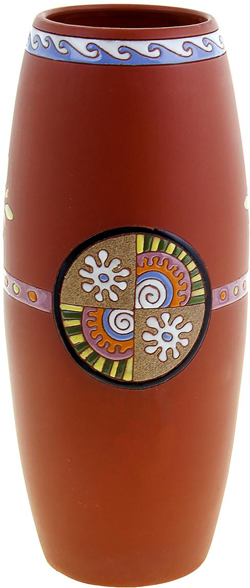 Ваза Солнце, цвет: коричневый, 35 см1044656Прекрасная Ваза Солнце выполнена вручную из глины вьетнамскими мастерами-ремесленниками. Они создавали её в несколько этапов, придерживаясь традиций своих предков. Глина – экологически чистый материал, именно это и подкупает. Ведь её можно использовать не только как украшение, но и в быту. Взгляните на этот прекрасный орнамент. Лаконичность и элегантность – то, чего так часто не достает практически в каждом интерьере дома или офиса. Тогда пусть такой волшебный сосуд заполнит эту пустоту и обогатит комнату необычайным теплом и уютом.