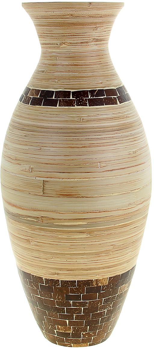 Ваза Квадро, цвет: бежевый, 63 см1044810Невероятной красоты Ваза Квадро 63 см выполнена вручную искусными ремесленниками экзотического Вьетнама. Поражает то, как автор совмещает материалы: сама ваза выполнена из натурального бамбука и инкрустирована частичками кокосового ореха. Прекрасное изделие, которое будет не только оригинальным предметом интерьера, но и настоящей гордостью для ценителя азиатской культуры. Преподнесите её молодожёнам на пятилетнюю годовщину свадьбы, а также даме на 8 Марта или День рождения. Пусть частичка загадочной страны украсит Ваш интерьер! Не желательно в вазу наливать воду, так как она плохо переносит сырость из-за отсутствия лака на внутренних стенках. Отлично подойдет в качестве украшения дома или офиса, а также под декоративные цветы.