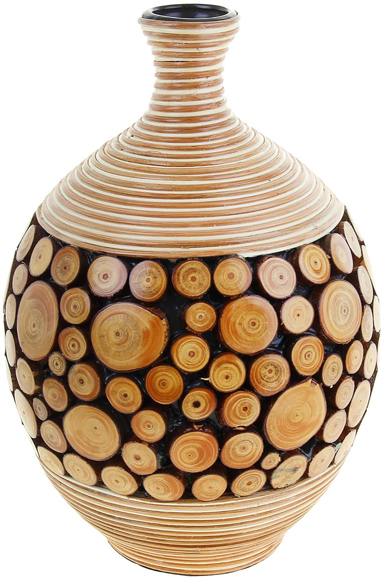 Ваза Виктория, цвет: бежевый, 37 см1048145Глядя на эту невероятную вазу, невольно задаёшься вопросом: «Как вьетнамским мастерам удалось это сделать, объединить несколько абсолютно различных высококлассных материалов?» Ваза Виктория, 37 см - шедевр в полном смысле этого слова. Вьетнамские мастера вручную создавали её, в несколько этапов и даже дней. Вы только посмотрите на эти маленькие пенёчки, так и хочется дотронуться до них, прикоснуться к каждой детали этой вазы… Её можно преподнести даме с хорошим вкусом, на праздник или даже без повода, ведь для такого роскошного подарка не нужна причина. Ваза будет отлично смотреться в интерьере гостиной комнаты у Вас дома, в офисе, например, в переговорной, приёмной, чтобы Ваши партнеры по бизнесу или коллеги смогли любоваться ей.