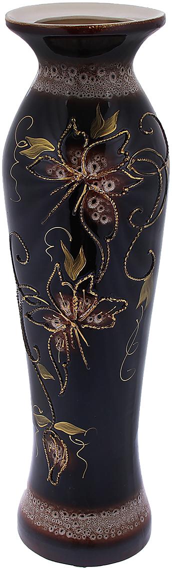 Ваза напольная Керамика ручной работы Азиза, цвет: черный1091303Это ваза - отличный способ подчеркнуть общий стиль интерьера. Существует множество причин иметь такой предмет дома. Вот лишь некоторые из них: Формирование праздничного настроения. Можно украсить вазу к Новому году гирляндой, тюльпанами на 8 марта, розами на день Святого Валентина, вербой на Пасху. За счёт того, что это заметный элемент интерьера, вы легко и быстро создадите во всём доме праздничное настроение. Заполнение углов, подиумов, ниш. Таким образом можно сделать обстановку более уютной и многогранной. Создание групповой композиции. Если позволяет площадь пространства, разместите несколько ваз так, чтобы они сочетались по стилю или цветовому решению. Это придаст обстановке более завершённый вид. Подходящая форма и стиль этого предмета подчеркнут достоинства дизайна квартиры. Ваза может стать отличным подарком по любому поводу, ведь такой элемент интерьера практичен и способен каждый день создавать хорошее настроение!