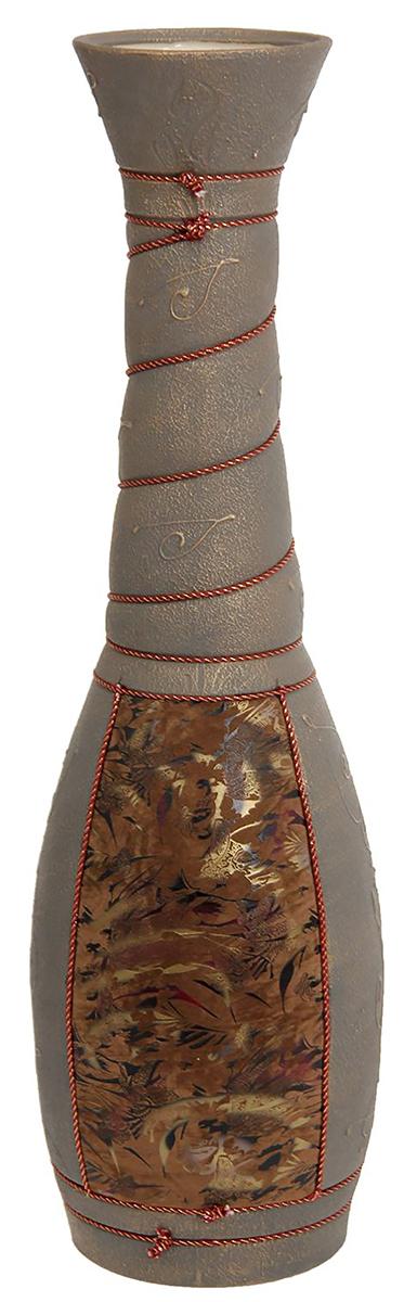 Ваза напольная Керамика ручной работы Сатурн, цвет: коричневый1136805Ваза напольная Сатурн - отличный способ подчеркнуть общий стиль интерьера.Существует множество причин иметь такой предмет дома. Вот лишь некоторые из них:Формирование праздничного настроения. Можно украсить вазу к Новому году гирляндой, тюльпанами на 8 марта, розами на день Святого Валентина, вербой на Пасху. За счёт того, что это заметный элемент интерьера, вы легко и быстро создадите во всём доме праздничное настроение.Заполнение углов, подиумов, ниш. Таким образом можно сделать обстановку более уютной и многогранной.Создание групповой композиции. Если позволяет площадь пространства, разместите несколько ваз так, чтобы они сочетались по стилю или цветовому решению. Это придаст обстановке более завершённый вид.Подходящая форма и стиль этого предмета подчеркнут достоинства дизайна квартиры. Ваза может стать отличным подарком по любому поводу, ведь такой элемент интерьера практичен и способен каждый день создавать хорошее настроение!