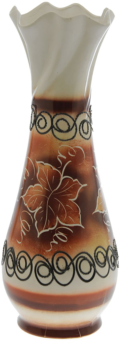 Ваза напольная Керамика ручной работы Вьюн, цвет: коричневый, глазурь. 11400881140088Ваза - сувенир в полном смысле этого слова. И главная его задача - хранить воспоминание о месте, где вы побывали, или о том человеке, который подарил данный предмет. Преподнесите эту вещь своему другу, и она станет достойным украшением его дома. Каждому хозяину периодически приходит мысль обновить свою квартиру, сделать ремонт, перестановку или кардинально поменять внешний вид каждой комнаты. Ваза - привлекательная деталь, которая поможет воплотить вашу интерьерную идею, создать неповторимую атмосферу в вашем доме. Окружите себя приятными мелочами, пусть они радуют глаз и дарят гармонию.