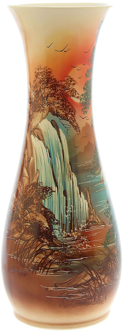 Ваза напольная Керамика ручной работы Осень, цвет: коричневый. 11482681148268Это ваза - отличный способ подчеркнуть общий стиль интерьера.Существует множество причин иметь такой предмет дома. Вот лишь некоторые из них:Формирование праздничного настроения. Можно украсить вазу к Новому году гирляндой, тюльпанами на 8 марта, розами на день Святого Валентина, вербой на Пасху. За счёт того, что это заметный элемент интерьера, вы легко и быстро создадите во всём доме праздничное настроение.Заполнение углов, подиумов, ниш. Таким образом можно сделать обстановку более уютной и многогранной.Создание групповой композиции. Если позволяет площадь пространства, разместите несколько ваз так, чтобы они сочетались по стилю или цветовому решению. Это придаст обстановке более завершённый вид.Подходящая форма и стиль этого предмета подчеркнут достоинства дизайна квартиры. Ваза может стать отличным подарком по любому поводу, ведь такой элемент интерьера практичен и способен каждый день создавать хорошее настроение!