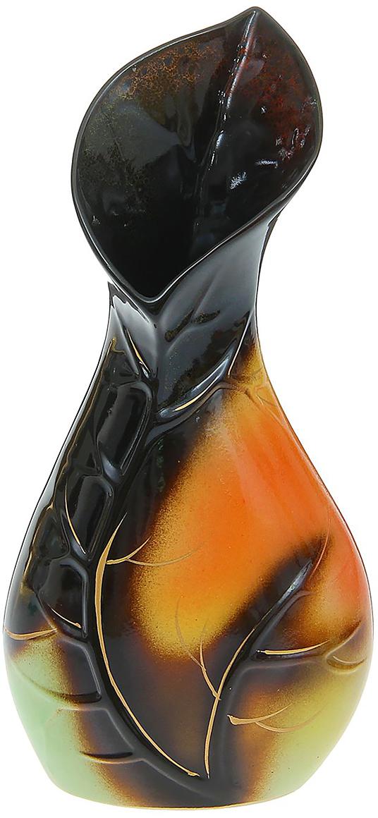 Ваза Керамика ручной работы Листок, цвет: темно-коричневый1169300Ваза - сувенир в полном смысле этого слова. И главная его задача - хранить воспоминание о месте, где вы побывали, или о том человеке, который подарил данный предмет. Преподнесите эту вещь своему другу, и она станет достойным украшением его дома. Каждому хозяину периодически приходит мысль обновить свою квартиру, сделать ремонт, перестановку или кардинально поменять внешний вид каждой комнаты. Ваза - привлекательная деталь, которая поможет воплотить вашу интерьерную идею, создать неповторимую атмосферу в вашем доме. Окружите себя приятными мелочами, пусть они радуют глаз и дарят гармонию.