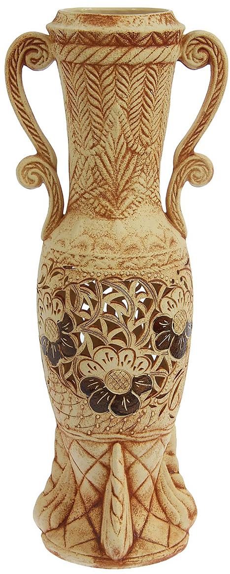 Ваза напольная Керамика ручной работы Афина, цвет: бежевый1239737Это ваза - отличный способ подчеркнуть общий стиль интерьера. Существует множество причин иметь такой предмет дома. Вот лишь некоторые из них: Формирование праздничного настроения. Можно украсить вазу к Новому году гирляндой, тюльпанами на 8 марта, розами на день Святого Валентина, вербой на Пасху. За счёт того, что это заметный элемент интерьера, вы легко и быстро создадите во всём доме праздничное настроение. Заполнение углов, подиумов, ниш. Таким образом можно сделать обстановку более уютной и многогранной. Создание групповой композиции. Если позволяет площадь пространства, разместите несколько ваз так, чтобы они сочетались по стилю или цветовому решению. Это придаст обстановке более завершённый вид. Подходящая форма и стиль этого предмета подчеркнут достоинства дизайна квартиры. Ваза может стать отличным подарком по любому поводу, ведь такой элемент интерьера практичен и способен каждый день создавать хорошее настроение!