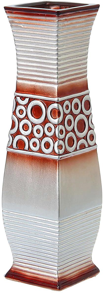 Ваза напольная Кольца, цвет: серый, 60 см. 12748941274894Ваза напольная Кольца прямая - сувенир в полном смысле этого слова. И главная его задача - хранить воспоминание о месте, где вы побывали, или о том человеке, который подарил данный предмет. Преподнесите эту вещь своему другу, и она станет достойным украшением его дома. Каждому хозяину периодически приходит мысль обновить свою квартиру, сделать ремонт, перестановку или кардинально поменять внешний вид каждой комнаты. Ваза напольная Кольца прямая - привлекательная деталь, которая поможет воплотить вашу интерьерную идею, создать неповторимую атмосферу в вашем доме. Окружите себя приятными мелочами, пусть они радуют глаз и дарят гармонию.