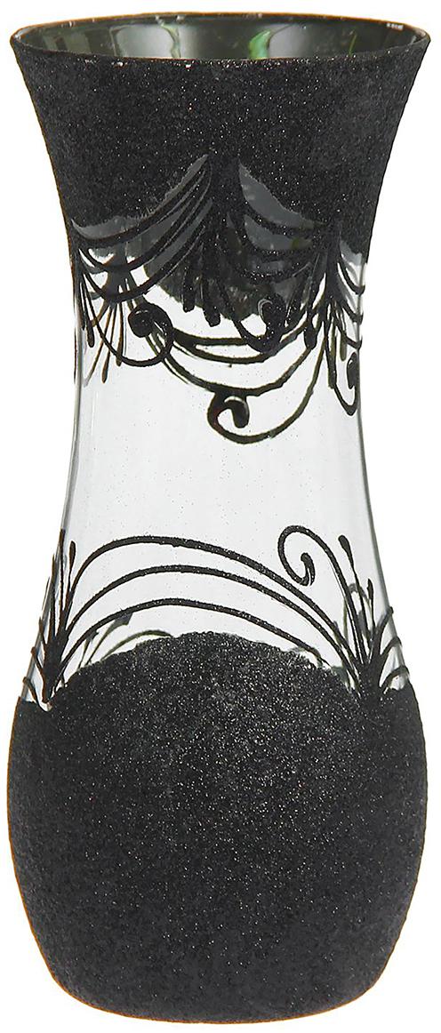 Ваза Мерцающая, цвет: черный, 26 см1275088Ваза - не просто сосуд для букета, а украшение убранства. Поставьте в неё цветы или декоративные веточки, и эффектный интерьерный акцент готов! Стеклянный аксессуар добавит помещению лёгкости. Ваза Мерцающая, чёрная, кувшин преобразит пространство и как самостоятельный элемент декора. Наполните интерьер уютом! Каждая ваза выдувается мастером. Второй точно такой же не встретить. А случайный пузырёк воздуха или застывшая стеклянная капелька на горлышке лишь подчёркивают её уникальность.
