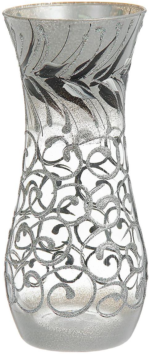 Ваза Индиго, цвет: серый, 26 см1275090Ваза - не просто сосуд для букета, а украшение убранства. Поставьте в неё цветы или декоративные веточки, и эффектный интерьерный акцент готов! Стеклянный аксессуар добавит помещению лёгкости. Ваза Индиго, кувшин преобразит пространство и как самостоятельный элемент декора. Наполните интерьер уютом! Каждая ваза выдувается мастером. Второй точно такой же не встретить. А случайный пузырёк воздуха или застывшая стеклянная капелька на горлышке лишь подчёркивают её уникальность.