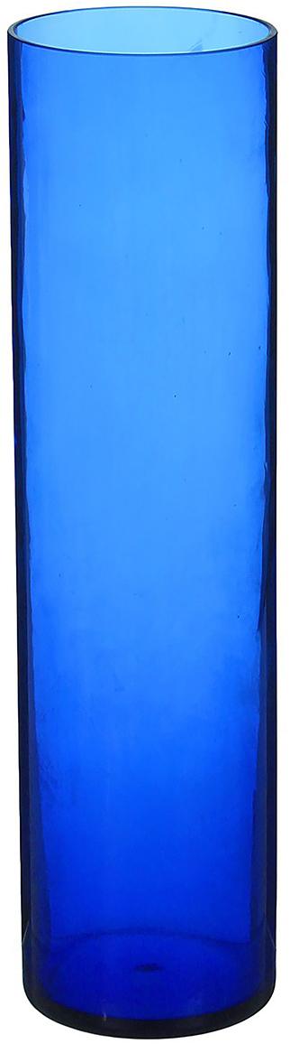 Ваза Цилиндр, цвет: синий, 30 см. 12982761298276Ваза - не просто сосуд для букета, а украшение убранства. Поставьте в неё цветы или декоративные веточки, и эффектный интерьерный акцент готов! Стеклянный аксессуар добавит помещению лёгкости. Ваза Цилиндр синяя преобразит пространство и как самостоятельный элемент декора. Наполните интерьер уютом! Каждая ваза выдувается мастером. Второй точно такой же не встретить. А случайный пузырёк воздуха или застывшая стеклянная капелька на горлышке лишь подчёркивают её уникальность.