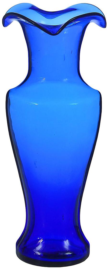 """Ваза - не просто сосуд для букета, а украшение убранства. Поставьте в неё цветы или декоративные веточки, и эффектный интерьерный акцент готов! Стеклянный аксессуар добавит помещению лёгкости.  Ваза """"Античность"""" синяя преобразит пространство и как самостоятельный элемент декора. Наполните интерьер уютом!  Каждая ваза выдувается мастером. Второй точно такой же не встретить. А случайный пузырёк воздуха или застывшая стеклянная капелька на горлышке лишь подчёркивают её уникальность."""