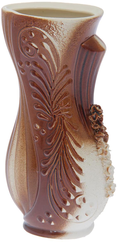 Ваза Керамика ручной работы Лиана, цвет: коричневый, малая1623055Ваза - сувенир в полном смысле этого слова. И главная его задача - хранить воспоминание о месте, где вы побывали, или о том человеке, который подарил данный предмет. Преподнесите эту вещь своему другу, и она станет достойным украшением его дома. Каждому хозяину периодически приходит мысль обновить свою квартиру, сделать ремонт, перестановку или кардинально поменять внешний вид каждой комнаты. Ваза - привлекательная деталь, которая поможет воплотить вашу интерьерную идею, создать неповторимую атмосферу в вашем доме. Окружите себя приятными мелочами, пусть они радуют глаз и дарят гармонию.