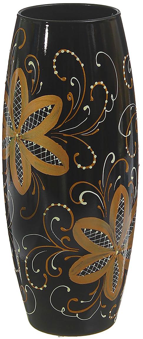 Ваза Чёрно-золотые цветы, цвет: черный, 25 см1659118Ваза - не просто сосуд для букета, а украшение убранства. Поставьте в неё цветы или декоративные веточки, и эффектный интерьерный акцент готов! Стеклянный аксессуар добавит помещению лёгкости. Ваза Чёрно-золотые цветы преобразит пространство и как самостоятельный элемент декора. Наполните интерьер уютом! Каждая ваза выдувается мастером. Второй точно такой же не встретить. А случайный пузырёк воздуха или застывшая стеклянная капелька на горлышке лишь подчёркивают её уникальность.
