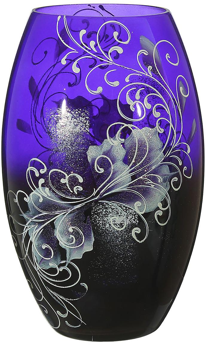 Ваза Чудо, цвет: фиолетовый, 25 см1696780Ваза - не просто сосуд для букета, а украшение убранства. Поставьте в неё цветы или декоративные веточки, и эффектный интерьерный акцент готов! Стеклянный аксессуар добавит помещению лёгкости. Ваза Чудо преобразит пространство и как самостоятельный элемент декора. Наполните интерьер уютом! Каждая ваза выдувается мастером. Второй точно такой же не встретить. А случайный пузырёк воздуха или застывшая стеклянная капелька на горлышке лишь подчёркивают её уникальность.