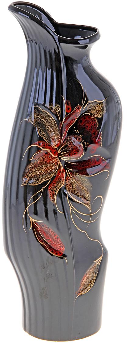 Ваза напольная Керамика ручной работы Флора, цвет: черный172493Это ваза - отличный способ подчеркнуть общий стиль интерьера. Существует множество причин иметь такой предмет дома. Вот лишь некоторые из них: Формирование праздничного настроения. Можно украсить вазу к Новому году гирляндой, тюльпанами на 8 марта, розами на день Святого Валентина, вербой на Пасху. За счёт того, что это заметный элемент интерьера, вы легко и быстро создадите во всём доме праздничное настроение. Заполнение углов, подиумов, ниш. Таким образом можно сделать обстановку более уютной и многогранной. Создание групповой композиции. Если позволяет площадь пространства, разместите несколько ваз так, чтобы они сочетались по стилю или цветовому решению. Это придаст обстановке более завершённый вид. Подходящая форма и стиль этого предмета подчеркнут достоинства дизайна квартиры. Ваза может стать отличным подарком по любому поводу, ведь такой элемент интерьера практичен и способен каждый день создавать хорошее настроение!
