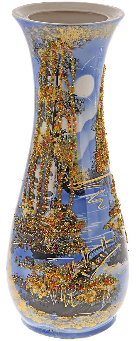 Ваза напольная Керамика ручной работы Осень, цвет: синий, бисер172530Это ваза - отличный способ подчеркнуть общий стиль интерьера. Существует множество причин иметь такой предмет дома. Вот лишь некоторые из них: Формирование праздничного настроения. Можно украсить вазу к Новому году гирляндой, тюльпанами на 8 марта, розами на день Святого Валентина, вербой на Пасху. За счёт того, что это заметный элемент интерьера, вы легко и быстро создадите во всём доме праздничное настроение. Заполнение углов, подиумов, ниш. Таким образом можно сделать обстановку более уютной и многогранной. Создание групповой композиции. Если позволяет площадь пространства, разместите несколько ваз так, чтобы они сочетались по стилю или цветовому решению. Это придаст обстановке более завершённый вид. Подходящая форма и стиль этого предмета подчеркнут достоинства дизайна квартиры. Ваза может стать отличным подарком по любому поводу, ведь такой элемент интерьера практичен и способен каждый день создавать хорошее настроение!