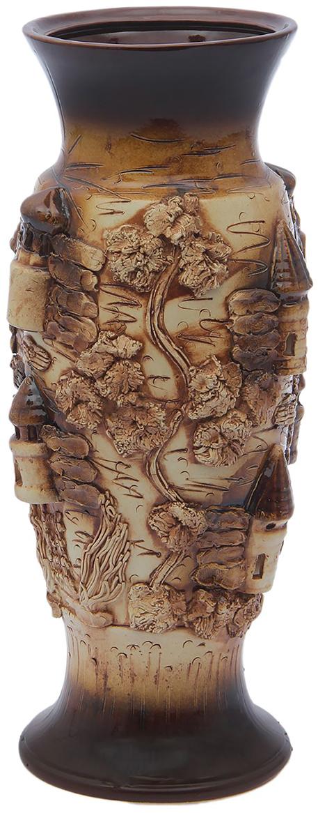 Ваза напольная Керамика ручной работы Венеция, цвет: коричневый. 18141811814181Это ваза - отличный способ подчеркнуть общий стиль интерьера. Существует множество причин иметь такой предмет дома. Вот лишь некоторые из них: Формирование праздничного настроения. Можно украсить вазу к Новому году гирляндой, тюльпанами на 8 марта, розами на день Святого Валентина, вербой на Пасху. За счёт того, что это заметный элемент интерьера, вы легко и быстро создадите во всём доме праздничное настроение. Заполнение углов, подиумов, ниш. Таким образом можно сделать обстановку более уютной и многогранной. Создание групповой композиции. Если позволяет площадь пространства, разместите несколько ваз так, чтобы они сочетались по стилю или цветовому решению. Это придаст обстановке более завершённый вид. Подходящая форма и стиль этого предмета подчеркнут достоинства дизайна квартиры. Ваза может стать отличным подарком по любому поводу, ведь такой элемент интерьера практичен и способен каждый день создавать хорошее настроение!