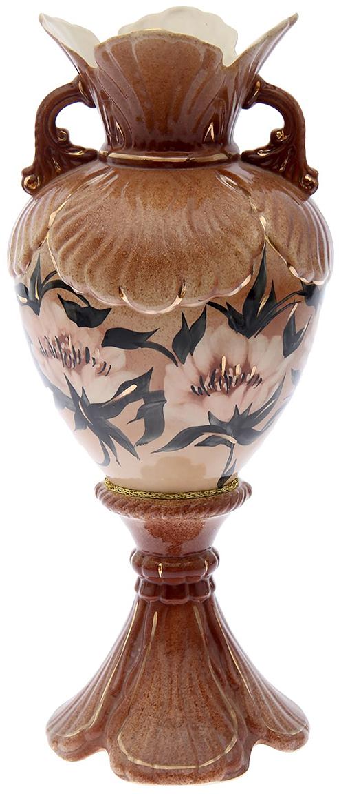 Ваза напольная Керамика ручной работы Орхидея, цвет: коричневый193381Ваза напольная Орхидея крапле - отличный способ подчеркнуть общий стиль интерьера. Существует множество причин иметь такой предмет дома. Вот лишь некоторые из них: Формирование праздничного настроения. Можно украсить вазу к Новому году гирляндой, тюльпанами на 8 марта, розами на день Святого Валентина, вербой на Пасху. За счёт того, что это заметный элемент интерьера, вы легко и быстро создадите во всём доме праздничное настроение. Заполнение углов, подиумов, ниш. Таким образом можно сделать обстановку более уютной и многогранной. Создание групповой композиции. Если позволяет площадь пространства, разместите несколько ваз так, чтобы они сочетались по стилю или цветовому решению. Это придаст обстановке более завершённый вид. Подходящая форма и стиль этого предмета подчеркнут достоинства дизайна квартиры. Ваза может стать отличным подарком по любому поводу, ведь такой элемент интерьера практичен и способен каждый день создавать хорошее настроение!