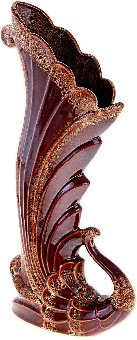 Ваза напольная Керамика ручной работы Жар-птица, цвет: коричневый196764Это ваза - отличный способ подчеркнуть общий стиль интерьера. Существует множество причин иметь такой предмет дома. Вот лишь некоторые из них: Формирование праздничного настроения. Можно украсить вазу к Новому году гирляндой, тюльпанами на 8 марта, розами на день Святого Валентина, вербой на Пасху. За счёт того, что это заметный элемент интерьера, вы легко и быстро создадите во всём доме праздничное настроение. Заполнение углов, подиумов, ниш. Таким образом можно сделать обстановку более уютной и многогранной. Создание групповой композиции. Если позволяет площадь пространства, разместите несколько ваз так, чтобы они сочетались по стилю или цветовому решению. Это придаст обстановке более завершённый вид. Подходящая форма и стиль этого предмета подчеркнут достоинства дизайна квартиры. Ваза может стать отличным подарком по любому поводу, ведь такой элемент интерьера практичен и способен каждый день создавать хорошее настроение!