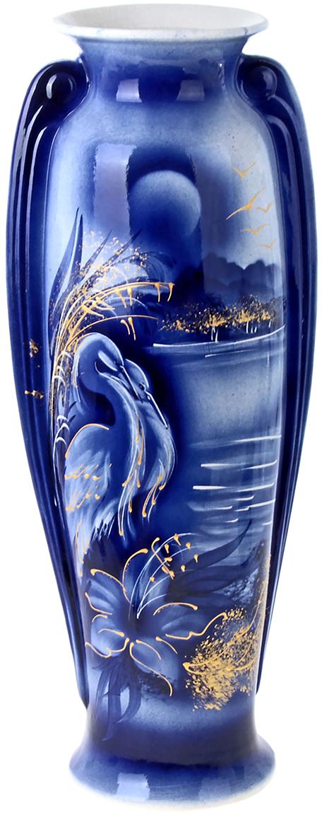 Ваза напольная Керамика ручной работы Ева, цвет: синий, 66 см198947Это ваза - отличный способ подчеркнуть общий стиль интерьера. Существует множество причин иметь такой предмет дома. Вот лишь некоторые из них: Формирование праздничного настроения. Можно украсить вазу к Новому году гирляндой, тюльпанами на 8 марта, розами на день Святого Валентина, вербой на Пасху. За счёт того, что это заметный элемент интерьера, вы легко и быстро создадите во всём доме праздничное настроение. Заполнение углов, подиумов, ниш. Таким образом можно сделать обстановку более уютной и многогранной. Создание групповой композиции. Если позволяет площадь пространства, разместите несколько ваз так, чтобы они сочетались по стилю или цветовому решению. Это придаст обстановке более завершённый вид. Подходящая форма и стиль этого предмета подчеркнут достоинства дизайна квартиры. Ваза может стать отличным подарком по любому поводу, ведь такой элемент интерьера практичен и способен каждый день создавать хорошее настроение!
