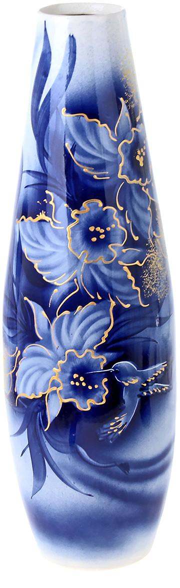 Ваза напольная Керамика ручной работы Катюша, цвет: синий, 53 см198980Это ваза - отличный способ подчеркнуть общий стиль интерьера. Существует множество причин иметь такой предмет дома. Вот лишь некоторые из них: Формирование праздничного настроения. Можно украсить вазу к Новому году гирляндой, тюльпанами на 8 марта, розами на день Святого Валентина, вербой на Пасху. За счёт того, что это заметный элемент интерьера, вы легко и быстро создадите во всём доме праздничное настроение. Заполнение углов, подиумов, ниш. Таким образом можно сделать обстановку более уютной и многогранной. Создание групповой композиции. Если позволяет площадь пространства, разместите несколько ваз так, чтобы они сочетались по стилю или цветовому решению. Это придаст обстановке более завершённый вид. Подходящая форма и стиль этого предмета подчеркнут достоинства дизайна квартиры. Ваза может стать отличным подарком по любому поводу, ведь такой элемент интерьера практичен и способен каждый день создавать хорошее настроение!