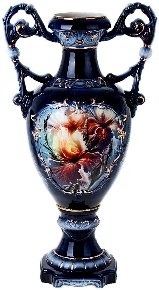 Ваза напольная Керамика ручной работы Флорена, цвет: синий. 198983198983Это ваза - отличный способ подчеркнуть общий стиль интерьера. Существует множество причин иметь такой предмет дома. Вот лишь некоторые из них: Формирование праздничного настроения. Можно украсить вазу к Новому году гирляндой, тюльпанами на 8 марта, розами на день Святого Валентина, вербой на Пасху. За счёт того, что это заметный элемент интерьера, вы легко и быстро создадите во всём доме праздничное настроение. Заполнение углов, подиумов, ниш. Таким образом можно сделать обстановку более уютной и многогранной. Создание групповой композиции. Если позволяет площадь пространства, разместите несколько ваз так, чтобы они сочетались по стилю или цветовому решению. Это придаст обстановке более завершённый вид. Подходящая форма и стиль этого предмета подчеркнут достоинства дизайна квартиры. Ваза может стать отличным подарком по любому поводу, ведь такой элемент интерьера практичен и способен каждый день создавать хорошее настроение!