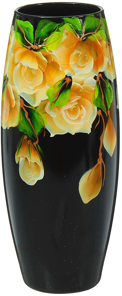 """Стеклянная ваза """"Чёрная в цветах"""" - сувенир в полном смысле этого слова. И главная его задача - хранить воспоминание о месте, где вы побывали, или о том человеке, который подарил данный предмет. Преподнесите эту вещь своему другу, и она станет достойным украшением его дома.<br. Каждому хозяину периодически приходит мысль обновить свою квартиру, сделать ремонт, перестановку или кардинально поменять внешний вид каждой комнаты. Ваза - привлекательная деталь, которая поможет воплотить вашу интерьерную идею, создать неповторимую атмосферу в вашем доме. Окружите себя приятными мелочами, пусть они радуют глаз и дарят гармонию."""