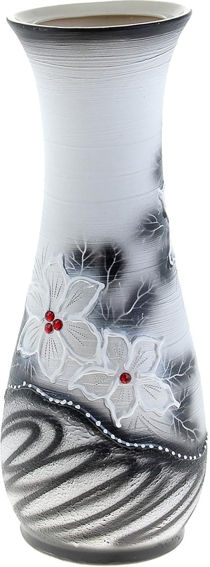 Ваза напольная Керамика ручной работы Осень, цвет: белый233877Это ваза - отличный способ подчеркнуть общий стиль интерьера. Существует множество причин иметь такой предмет дома. Вот лишь некоторые из них: Формирование праздничного настроения. Можно украсить вазу к Новому году гирляндой, тюльпанами на 8 марта, розами на день Святого Валентина, вербой на Пасху. За счёт того, что это заметный элемент интерьера, вы легко и быстро создадите во всём доме праздничное настроение. Заполнение углов, подиумов, ниш. Таким образом можно сделать обстановку более уютной и многогранной. Создание групповой композиции. Если позволяет площадь пространства, разместите несколько ваз так, чтобы они сочетались по стилю или цветовому решению. Это придаст обстановке более завершённый вид. Подходящая форма и стиль этого предмета подчеркнут достоинства дизайна квартиры. Ваза может стать отличным подарком по любому поводу, ведь такой элемент интерьера практичен и способен каждый день создавать хорошее настроение!