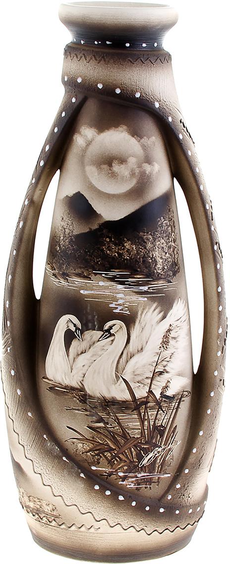Ваза напольная Керамика ручной работы Венеция, цвет: серый309658Это ваза - отличный способ подчеркнуть общий стиль интерьера. Существует множество причин иметь такой предмет дома. Вот лишь некоторые из них: Формирование праздничного настроения. Можно украсить вазу к Новому году гирляндой, тюльпанами на 8 марта, розами на день Святого Валентина, вербой на Пасху. За счёт того, что это заметный элемент интерьера, вы легко и быстро создадите во всём доме праздничное настроение. Заполнение углов, подиумов, ниш. Таким образом можно сделать обстановку более уютной и многогранной. Создание групповой композиции. Если позволяет площадь пространства, разместите несколько ваз так, чтобы они сочетались по стилю или цветовому решению. Это придаст обстановке более завершённый вид. Подходящая форма и стиль этого предмета подчеркнут достоинства дизайна квартиры. Ваза может стать отличным подарком по любому поводу, ведь такой элемент интерьера практичен и способен каждый день создавать хорошее настроение!