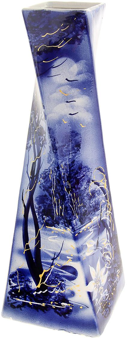 Ваза Керамика ручной работы Эквилибриум, цвет: синий, большая.749046ВазаКерамика ручной работы Эквилибриум не только станет прекрасным элементом декора помещения, но и сохранит свежесть вашего букета на долгое время. Подобно термосу, керамические сосуды сохраняют воду прохладной даже при высокой внешней температуре. Доказано, в керамической вазе цветы стоят почти в 2 раза дольше.ВазаКерамика ручной работы Эквилибриум станет прекрасным подарком на любое торжество.