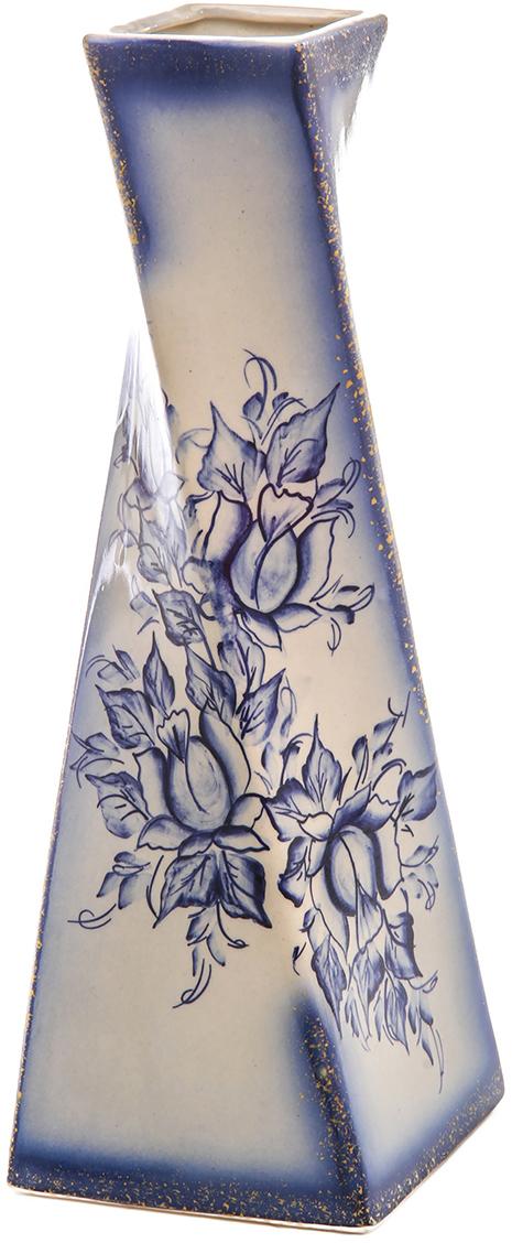 Ваза Керамика ручной работы Эквилибриум, цвет: синий, гжель774783Ваза форма Эквилибриум Гжель украсит любую квартиру, дачу или офис. Преподнести её в качестве подарка друзьям или близким – отличная идея. Необычный дизайн и расцветка может вписаться в интерьер или стать его ярким, уникальным акцентом. Особые свойства керамики делают вазы из этого материала очень популярными. Цветы простоят дольше, потому что керамика отлично регулирует температуру. Вода останется прохладной даже при высокой температуре в помещении.