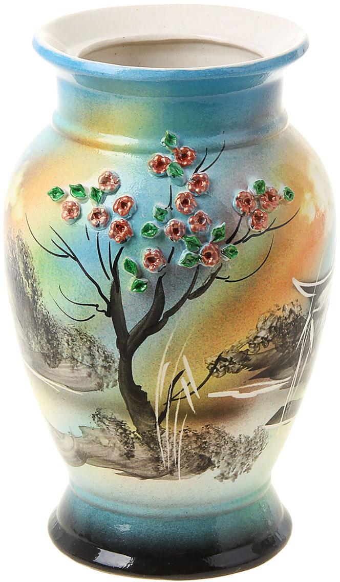 Ваза Керамика ручной работы Севастьяна, цвет: голубой776262Ваза из керамики не только станет прекрасным элементом декора помещения, но и сохранит свежесть вашего букета на долгое время. Подобно термосу, керамические сосуды сохраняют воду прохладной даже при высокой внешней температуре. Доказано, в керамической вазе цветы стоят почти в 2 раза дольше.