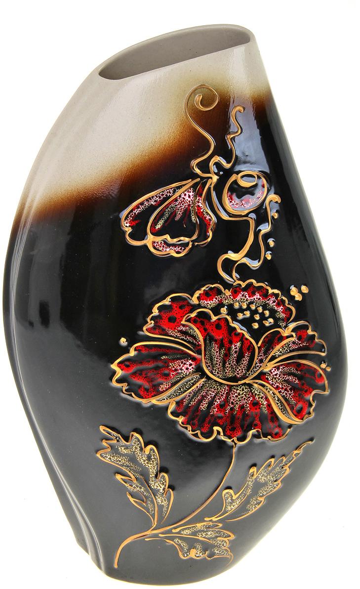 Ваза Керамика ручной работы Каприз, цвет: черный788030Не знаете чем разнообразить надоевший интерьер? Шикарная роспись этих настольных ваз впишется в любое помещение. Подарите такую вазу близкому человеку на любой праздник, и он останется доволен.