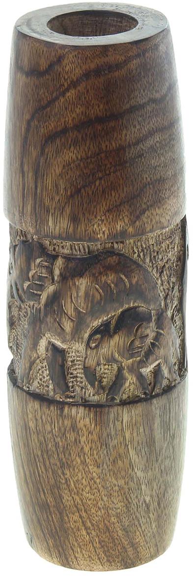 Ваза Слоны, цвет: коричневый, 25 см806567Великолепная Ваза Слоны средняя - это не просто предмет интерьера, а настоящий шедевр, выполненный вручную индийскими мастерами-ремесленниками из натурального дерева. Вы только посмотрите на этих невероятно мощных резных слонов, которые стремительно идут вперед, а эти массивные стенки, которые удержат любой Ваш букет. Ваза станет актуальным и в то же время ценным подарком даме на 8 Марта, день рождения или семейной паре по случаю «деревянной свадьбы».