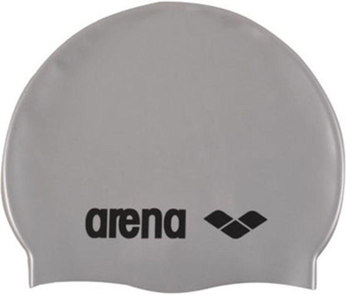 Шапочка для плавания Arena Classic Silicone Cap, цвет: серебристый, черныйУТ-00008451Шапочка для плавания (силиконовая) Arena Classic Silicone Cap - комфортная мягкая шапочка для тренировок. Классическая плоская форма.Модель шапочки для плавания из силикона на ощупь материал препятствует склеиванию и прилипанию волос, облегчает снятие шапочки после использования.Силикон быстро сохнет, его не нужно посыпать тальком – достаточно после сеанса в бассейне сполоснуть шапочку в пресной проточной воде и высушить при комнатной температуре. Силиконовые шапочки довольно прочные, но длинные волосы лучше закреплять резинками, а не заколками. Силикон не вызывает аллергии и может использоваться людьми с чувствительной кожей.Недостаток шапочек для плавания из силикона – они довольно сильно сдавливают уши и лоб, что может вызвать дискомфорт.Характеристики:Материал: 100% силиконЦвет: silverРазмер: один