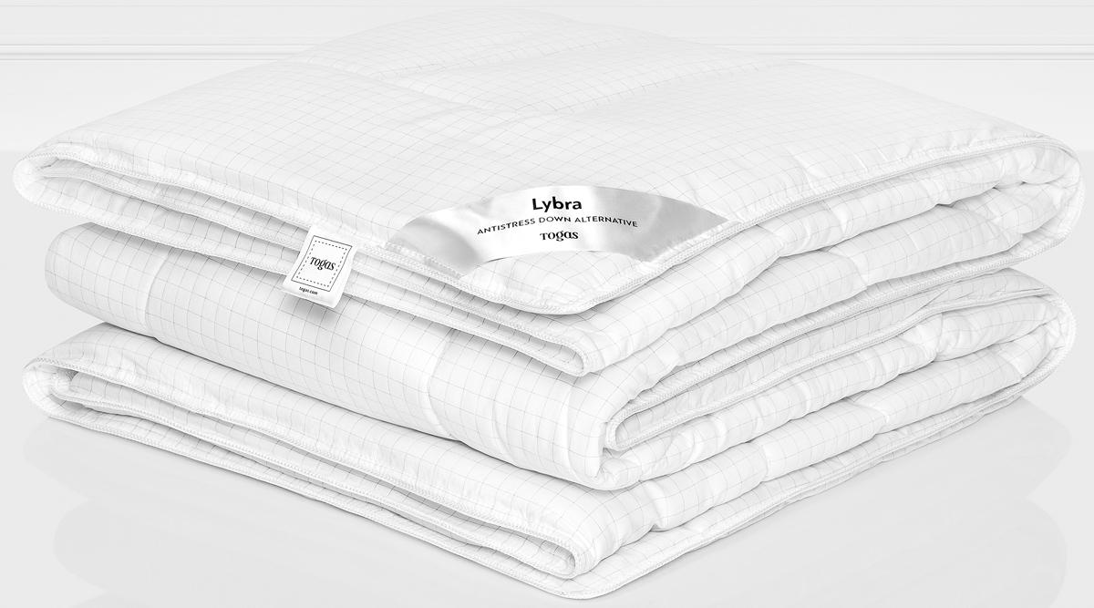 """Наполнитель одеяла Togas """"Либра"""" выполнен из микрофайбера. Это самый популярный материал  для изготовления одеял и подушек. Это искусственное волокно, которое обладает высокой  износоустойчивостью и прочностью, хорошо сохраняет форму, не мнется, гигроскопично. Одеяло  теплое, очень легкое, обеспечивает достаточную циркуляцию воздуха, гиппоаллергенно.  Отличный выбор, если вы страдаете аллергией.  Уход: может применяться машинная стирка при температуре не выше 30 C, не отбеливать, не  гладить, сухая чистка, сушить при низких температурах."""