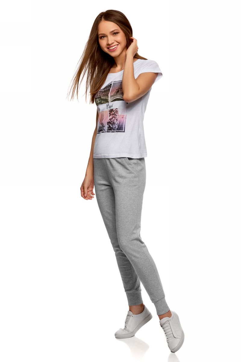 Брюки женские oodji Ultra, цвет: светло-серый меланж. 16701055B/47999/2000M. Размер S (44)16701055B/47999/2000MЖенские брюки, выполненные из натурального хлопка, подойдут как для повседневной носки, так и для занятий спортом. Модель на талии имеет широкую эластичную резинку со шнурком-кулиской. Спереди брюки оснащены двумя втачными карманами. Низ брючин дополнен трикотажными манжетами.
