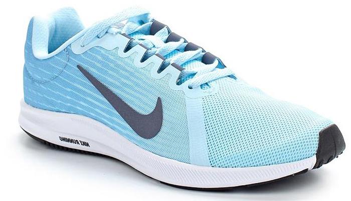 Кроссовки для бега женские Nike Downshifter 8, цвет: голубой. 908994-400. Размер 9 (39,5)908994-400Женские беговые кроссовки Downshifter 8 от Nike в минималистичном стиле выполнены из легкой однослойной сетки с обновленной амортизирующей стелькой, еще более мягкой, чем в предыдущих версиях. В сочетании с ремешком в области свода стопы, объединенным со шнурками, это обеспечивает индивидуальную посадку и плавный переход с пятки на носок. Верх из легкой сетки обеспечивает вентиляцию и комфорт. Регулируемый ремешок в области свода стопы обеспечивает индивидуальную посадку. Обновленная промежуточная подошва для мягкой и упругой амортизации. Рельефная конструкция внутренней части для безупречной посадки и удобного обувания. Эластичная полноразмерная подошва из материала Phylon обеспечивает упругую и легкую амортизацию, ее обновленная версия превосходит предшествующие по мягкости. Перепад: 10 мм (носок 13 мм, пятка 23 мм). Колодка: MR-10.