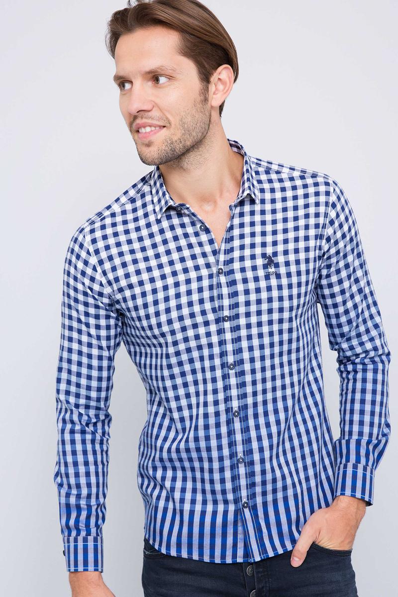 Рубашка мужская U.S. Polo Assn., цвет: синий. G081SZ004ARMAROBERGE. Размер L (52)G081SZ004ARMAROBERGE_синийМужская рубашка, выполненная из 100% хлопка, подчеркнет ваш уникальный стиль и поможет создать оригинальный образ. Такой материал великолепно пропускает воздух, обеспечивая необходимую вентиляцию, а также обладает высокой гигроскопичностью. Рубашка с длинными рукавами и отложным воротником застегивается на пуговицы спереди. Манжеты рукавов также застегиваются на пуговицы.